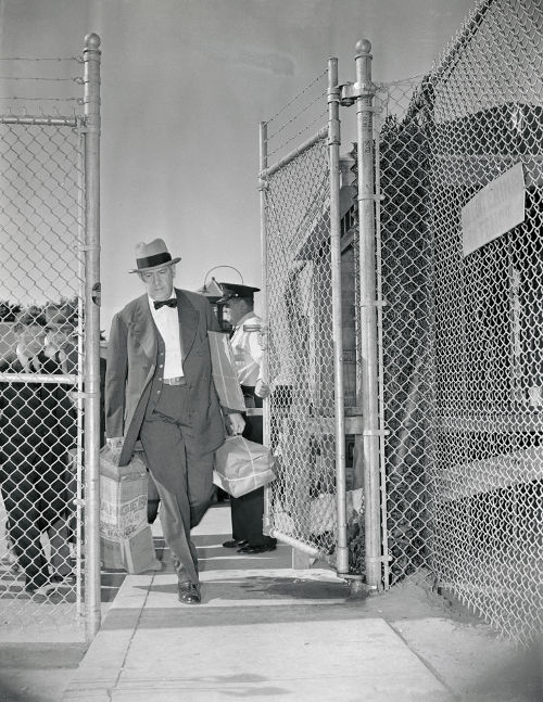 Getty Images - Richard Whitney Walking Through Prison Gates